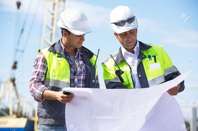29793442-Two-engineers-at-construction-site-are-inspecting-works-according-to-design-drawings--S.jpg